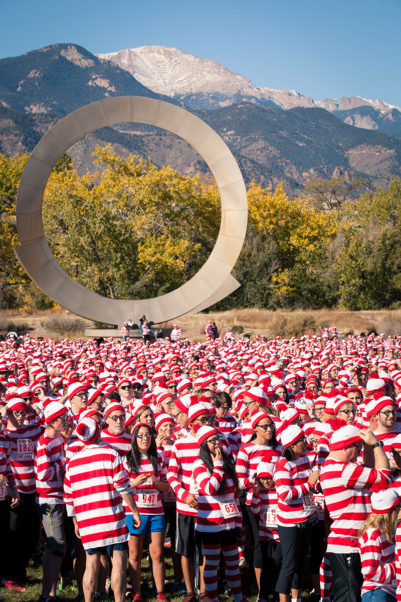 A crowd of Waldos in America the Beautifl Park with Pikes Peak in the background